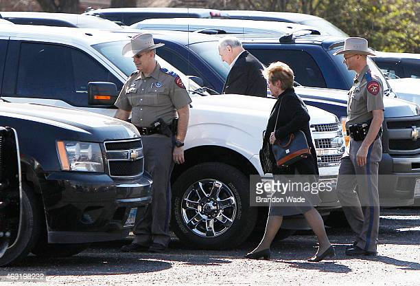 Judy Littlefield mother of Chad Littlefield is escorted by Texas state troopers to a waiting vehicle after leaving the Erath County Donald R Jones...