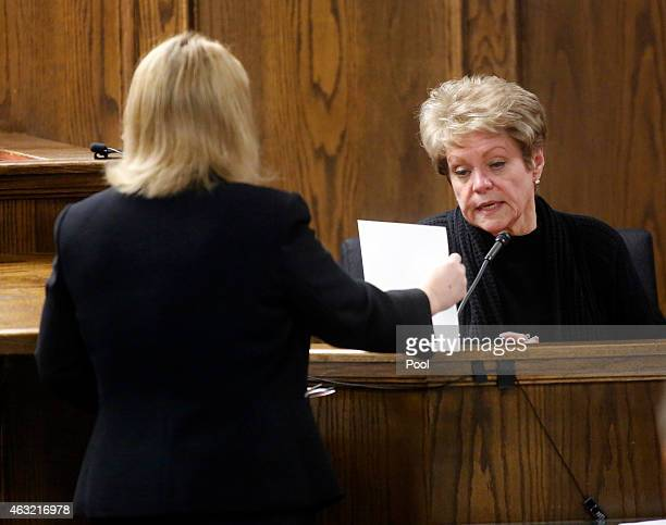 Judy Littlefield mother of Chad Littlefield is shown photos of her son by Assistant District Attorney Jane Starnes during the capital murder trial of...