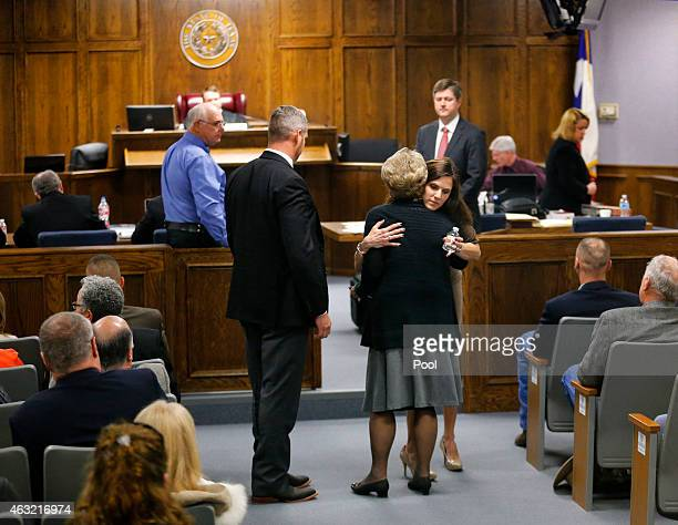 Judy Littlefield mother of Chad Littlefield receives a hug from Taya Kyle wife of former Navy SEAL Chris Kyle after Kyle's testimony during the...