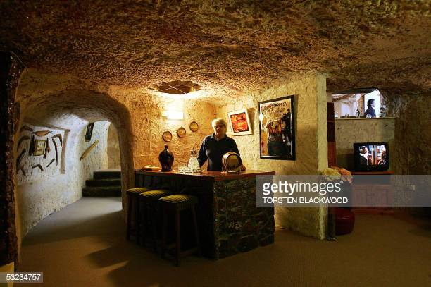Judy McLean displays the subterranean bar and lounge of Faye's underground house in the opal mining town of Coober Pedy 05 July 2005 located 840 kms...