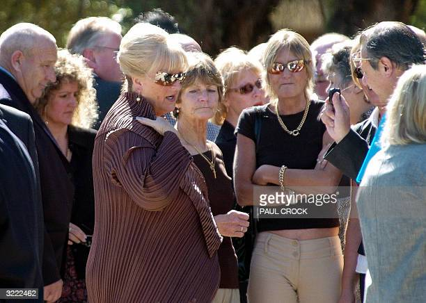 Judy Moran talks with mourners during the funeral of her ex-husband, crime-boss Lewis Moran, in Melbourne 06 April 2004. Moran was the 23rd victim of...