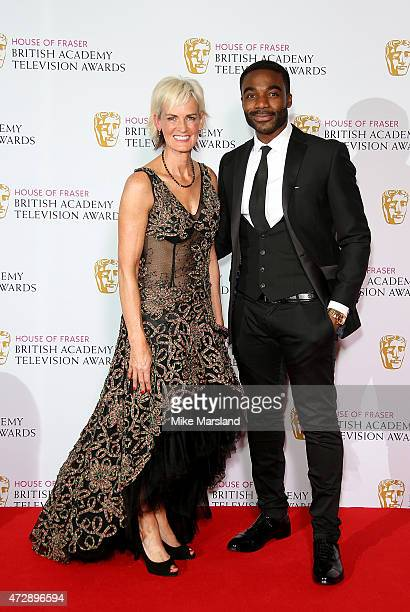 Judy Murray and Ore Oduba pose in the winners room at the House of Fraser British Academy Television Awards at Theatre Royal on May 10, 2015 in...