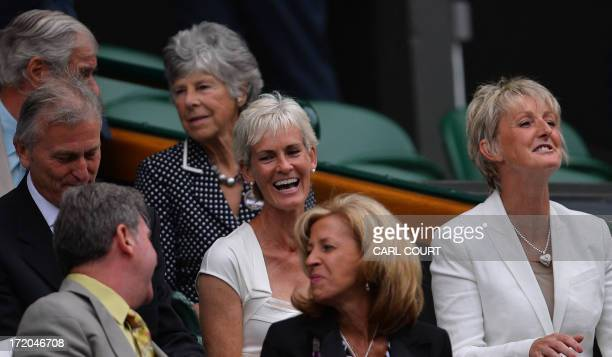 Judy Murray mother of Britain's Andy Murray laughs as she sits in the royal box at Centre Court ahead of the start of the the fourth round women's...