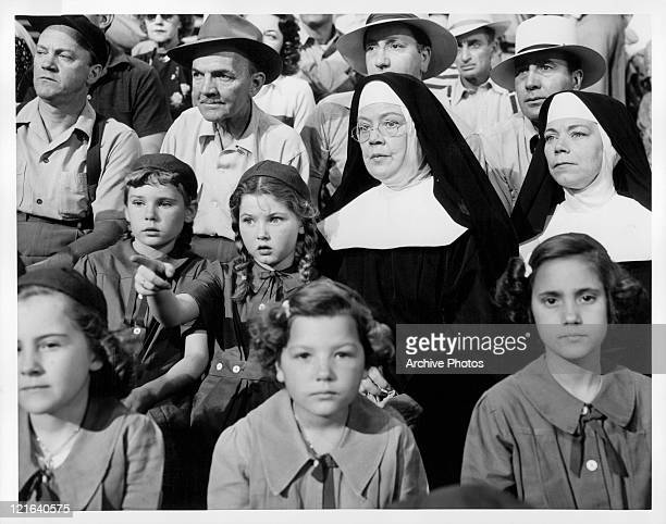 Judy Nugent and Donna Corcoran watch ball game while Spring Byington and Ellen Corby are their escorts in a scene from the film 'Angels And The...