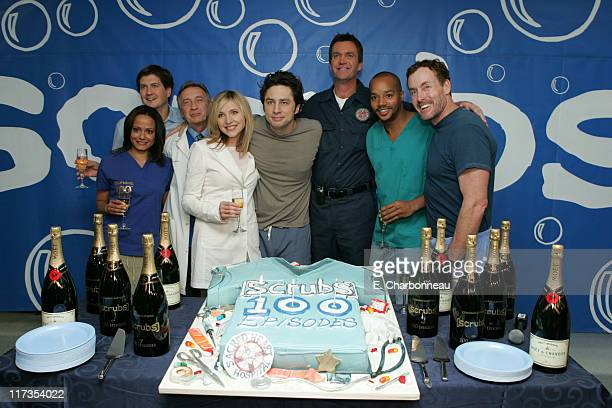 Judy Reyes producer Bill Lawrence Ken Jenkins Sarah Chalke Zach Braff Neil Flynn Donald Faison and John C McGinley celebrate the 100th episode of...