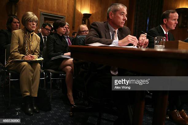 Judy Rivers of Logan Alabama who twice had been listed in the Social Security Death Master File listens as senior adviser to the deputy commissioner...