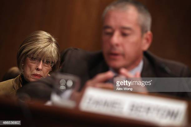 Judy Rivers of Logan Alabama who twice had been listed in the Social Security Death Master File listens as director of education workforce and income...