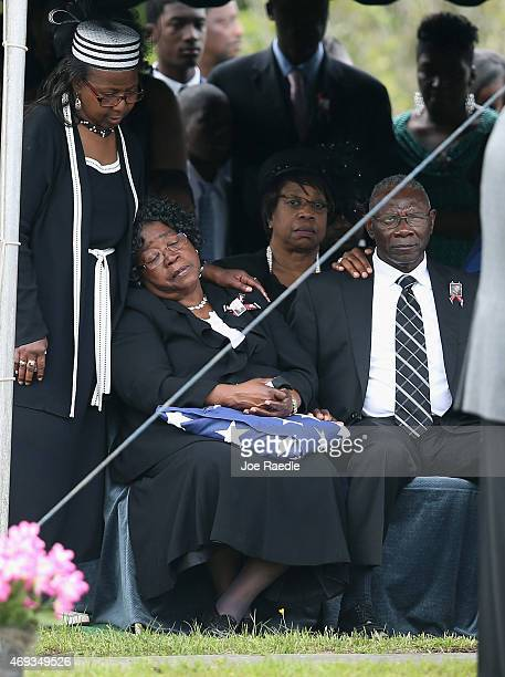 Judy Scott and her husband Walter Scott Sr attend the burial of their son Walter Scott at the Live Oak Memorial gardens cemetery after he was fatally...