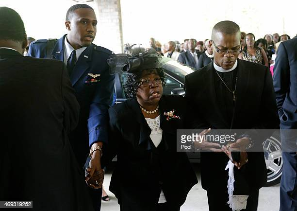 Judy Scott center is escorted in for the funeral of her son Walter Scott at WORD Ministries Christian Center April 11 2015 in Summerville South...