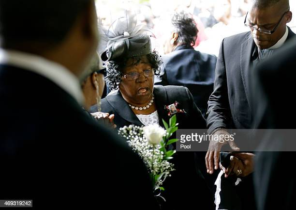 Judy Scott is escorted in for the funeral of her son Walter Scott at WORD Ministries Christian Center April 11 2015 in Summerville South Carolina...