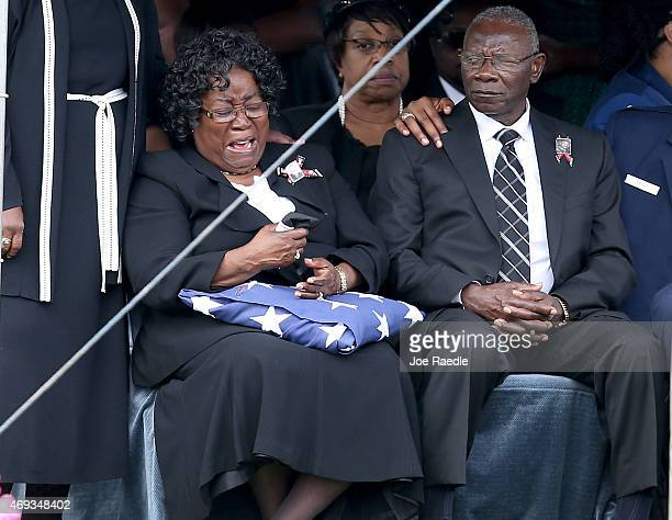 Judy Scott is overcome with emotion as she sits with her husband Walter Scott Sr during the burial service for their son Walter Scott at the Live Oak...