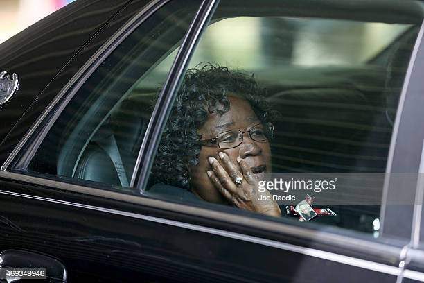 Judy Scott sits in a vehicle after the funeral for her son Walter Scott at the WORD Ministries Christian Center after he was fatally shot by a North...