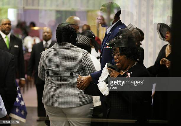 Judy Scott weeps as she is escorted in for the funeral of her son Walter Scott at WORD Ministries Christian Center April 11 2015 in Summerville South...