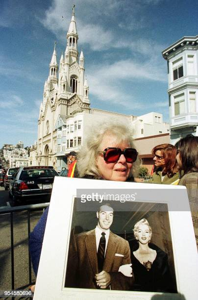 Judy Shapiro from Mill Valley California holds a picture of baseball great Joe DiMaggio and legendary actress Marilyn Monroe on their wedding day in...