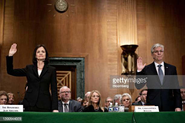Judy Shelton left and Christopher Waller US President Donald Trump's nominees for governors of the Federal Reserve swear in to a Senate Banking...