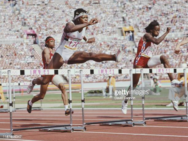 Judy Simpson of Great Britain and Jackie JoynerKersee during the 100 metres hurdle event of the Women's Heptathlon at the XXIII Summer Olympics on...