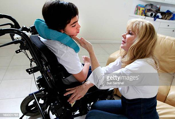 Judy Susser, right, of Boca Raton, Florida, is pictured December 6 with her disabled son Adam who has received stem-cell treatments. Adam was born...