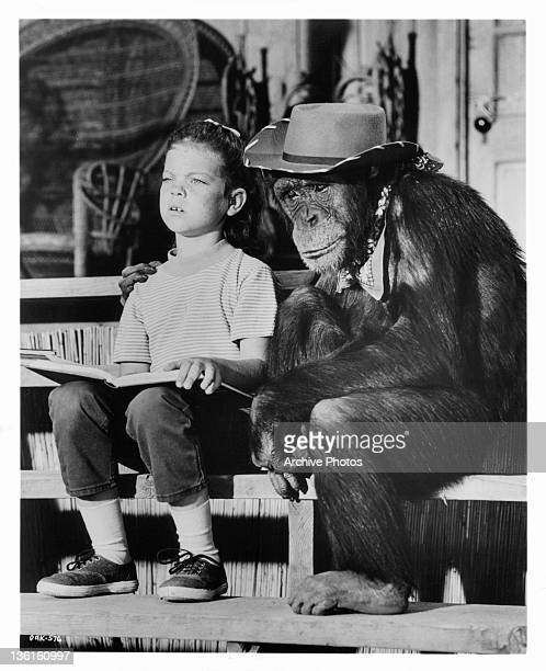 Judy the Chimp has her arm around Erin Moran in a scene from the television series 'Daktari' 1969