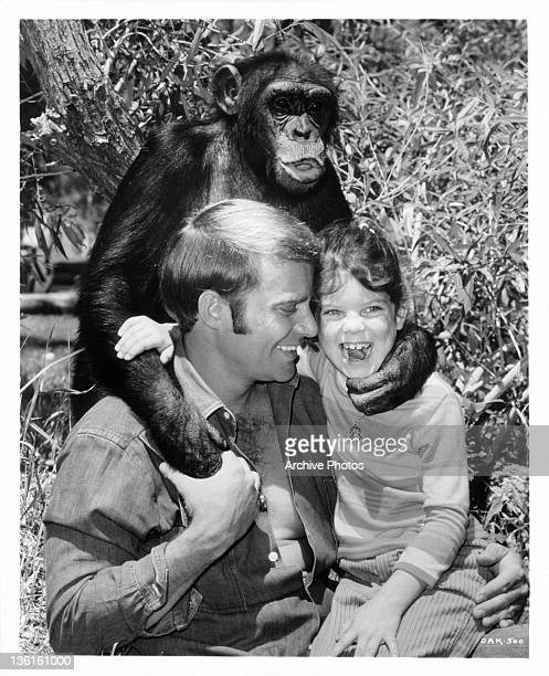 Judy the Chimp helps Ross Hagen and Erin Moran get acquainted with their surroundings in a scene from the television series 'Daktari', 1969.