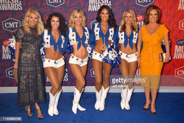 Judy Trammell Kelli Finglass and Dallas Cowboys Cheerleaders attend the 2019 CMT Music Awards at Bridgestone Arena on June 05 2019 in Nashville...