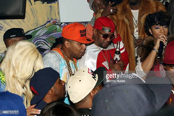 Juelz Santana Cam'ron and Deelishis attend Cam'ron'sKillaBowl at WIP on February 2 2014 in New York City