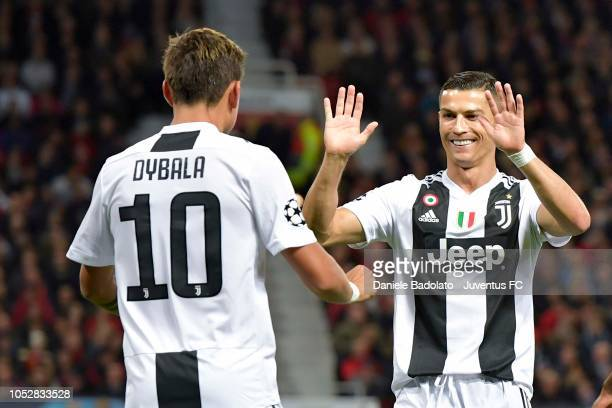 Juentus player Paulo Dybala celebrates scoring the 01 goal during the Group H match of the UEFA Champions League between Manchester United and...