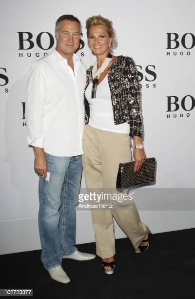 Juergen B. Harder and Franziska van Almsick arrive at the Boss Black Show during the Mercedes-Benz Fashion Week Spring/Summer 2011 on July 8, 2010 in...