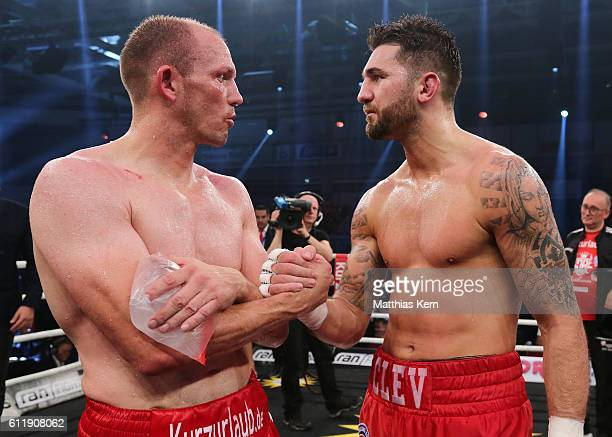 Juergen Braehmer of Germany congratulates Nathan Cleverly of Wales after the WBA light heavyweight world championship title fight at Jahnsportforum...