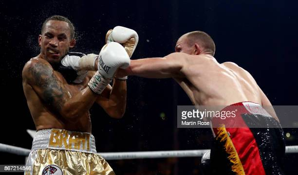 Juergen Braehmer of Germany exchange punches with Rob Brant of the United States during the Ali Trophy Super Middleweight QuarterFinal fight on...