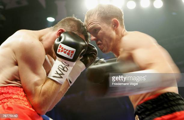 Juergen Braehmer of Germany exchanges punches during his WBO Super Middleweight InterContinental Championship fight with Mario Veit of Germany during...