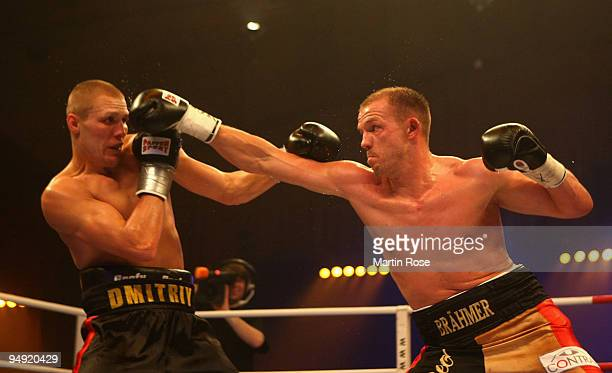 Juergen Braehmer of Germany exchanges punches with Dmitry Sukhotsky of Russia during the WBO light heavyweight world championship fight during the...