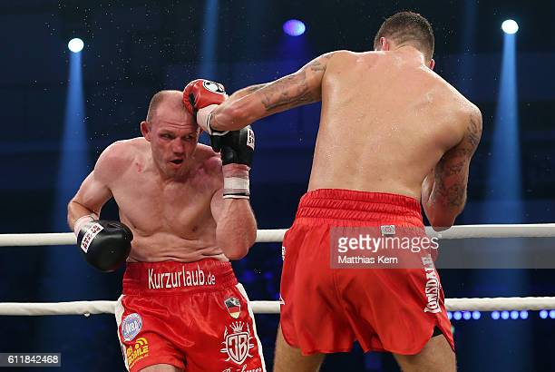 Juergen Braehmer of Germany exchanges punches with Nathan Cleverly of Wales during their WBA light heavyweight world championship title fight at...