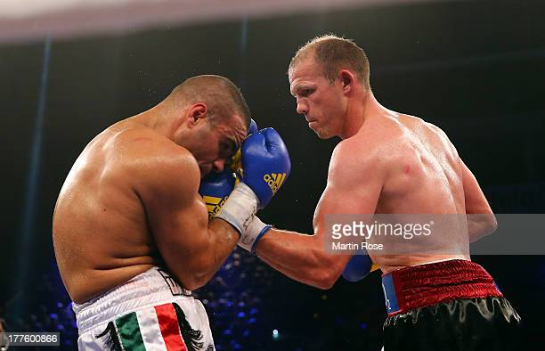 Juergen Braehmer of Germany exchanges punches with Stefano Abatangelo of Italy during their WBO International light heavyweight title fight at Sport...