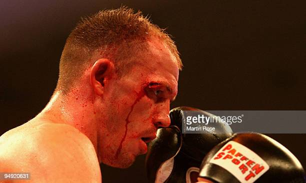 Juergen Braehmer of Germany seen with a cut during the WBO light heavyweight world championship fight during the Universum Champions night boxing at...