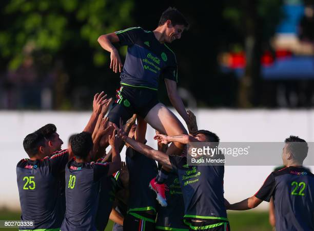 Juergen Damm is lifted up into the air by his team mates during a Mexico press conference at Fisht Olympic stadium ahead of their FIFA Confederations...