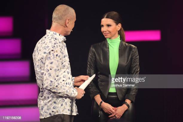 Juergen Domian and 'Special' award winner Teresa Enke of the RobertEnkeFund speak on stage at the 1Live Krone radio award at Jahrhunderthalle on...