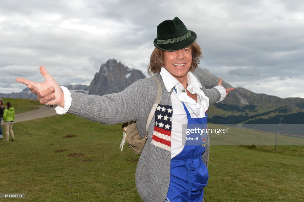 Juergen Drews pose for media after the recording of the TV Show 'ZDF Fernsehgarten' at Seiser Alm near Kastelruth on September 18, 2013 in Kastelruth, Italy.