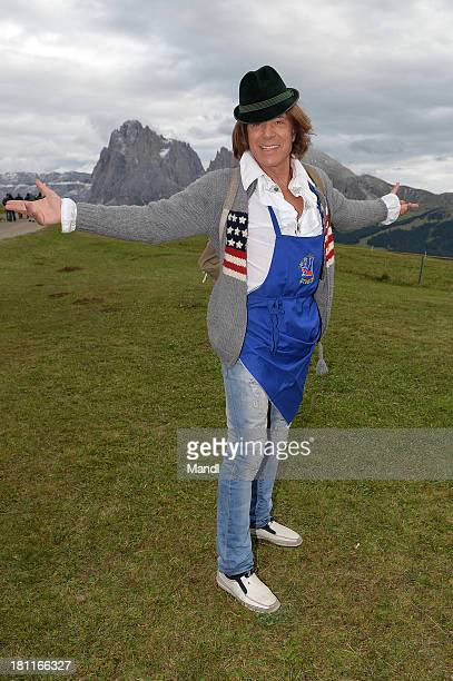 Juergen Drews pose for media after the recording of the TV Show 'ZDF Fernsehgarten' at Seiser Alm near Kastelruth on September 18 2013 in Kastelruth...
