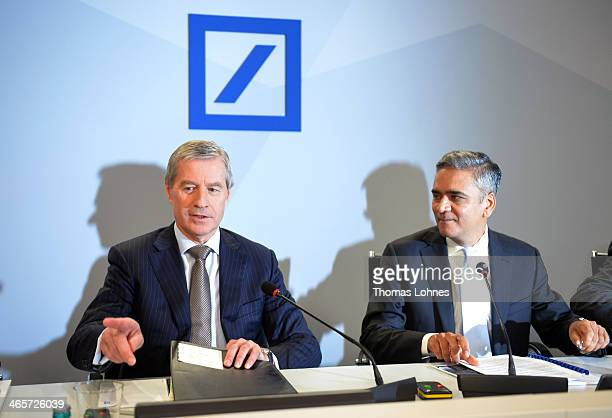 Juergen Fitschen and Anshu Jain the two coChairmen of German bank Deutsche Bank present financial results for 2013 at the company's annual press...