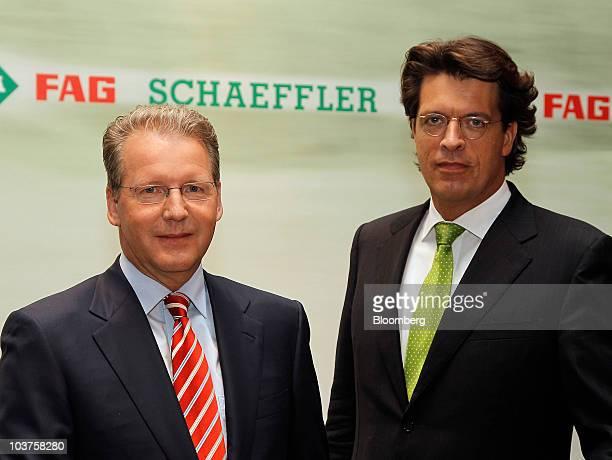 Juergen Geissinger chief executive officer of Schaeffler Group left and Klaus Rosenfeld chief financial officer of Schaeffler Group pose during a...