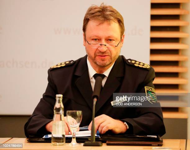 Juergen Georgie Head of Saxony state police speaks during a press conference following the events of Chemnitz on August 28 2018 in Dresden eastern...