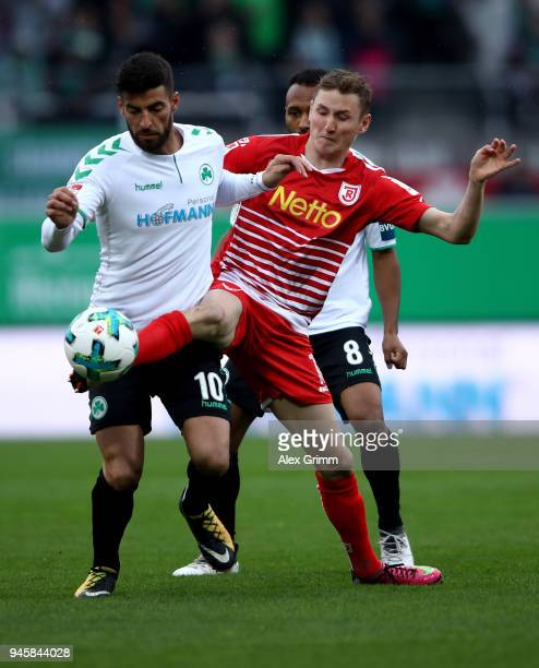 Juergen Gjasula of Fürth and Marc Lais of Regensburg battle for the ball during the Second Bundesliga match between SpVgg Greuther Fuerth and SSV...