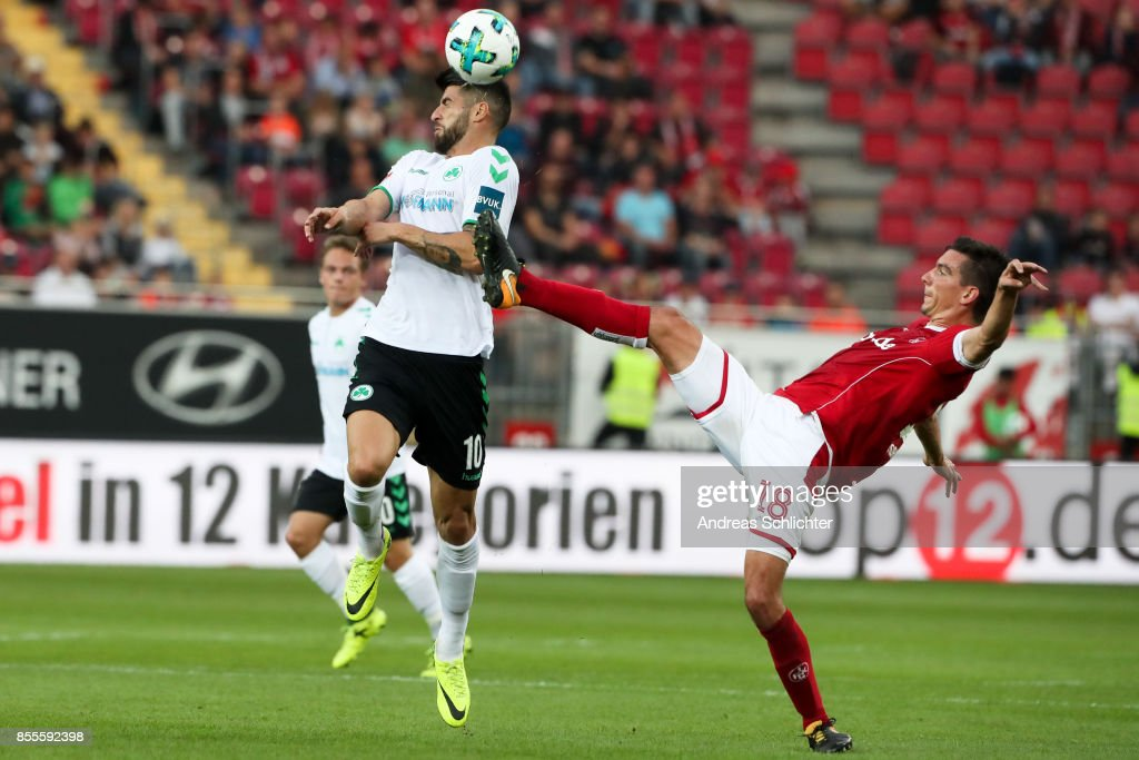 Juergen Gjasula of Greuther Fuerth challenges Christoph Moritz of 1.FC Kaiserslautern during the Second Bundesliga match between 1. FC Kaiserslautern and SpVgg Greuther Fuerth at Fritz-Walter-Stadion on September 29, 2017 in Kaiserslautern, Germany.
