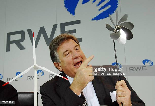 Juergen Grossmann chief executive of German energy group RWE holds a small windmill during a press conference 21 November 2007 in Essen western...