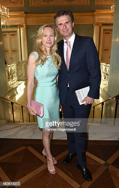 Juergen Hausmann and his wife Constanze Hausmann attend 'Oper fuer Alle' with the premiere of Manon Lescaut at the Staatsoper on July 31, 2015 in...