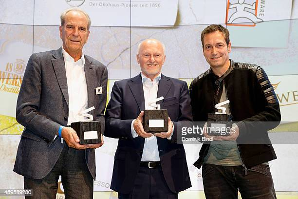Juergen Heraeus Dirk Rossmann and Dieter Nuhr pose with their award during the Querdenker Award 2014 at BMW World on November 25 2014 in Munich...