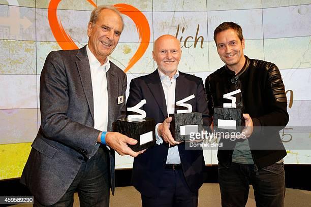 Juergen Heraeus Dirk Rossmann and Dieter Nuhr pose with their awards during the Querdenker Award 2014 at BMW World on November 25 2014 in Munich...