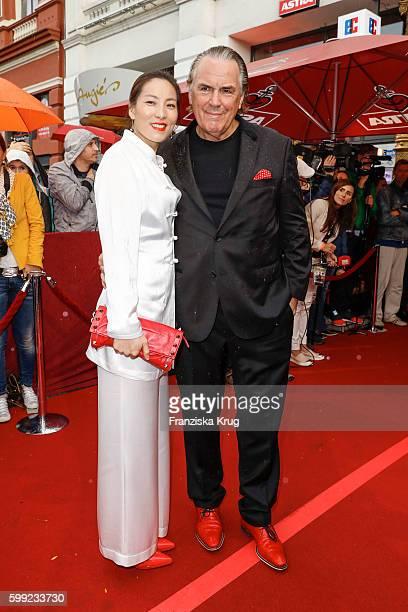 Juergen Hunke and his wife Chun Li attend the 'Nacht der Legenden' at Schmidts Tivoli on September 04 2016 in Hamburg Germany