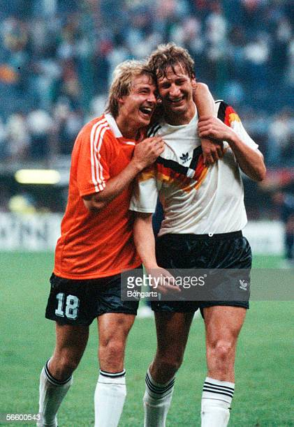 Juergen Klinsmann and Guido Buchwald of Germany celebrates after winning the World Cup eighth final match between Germany and Netherlands at the...