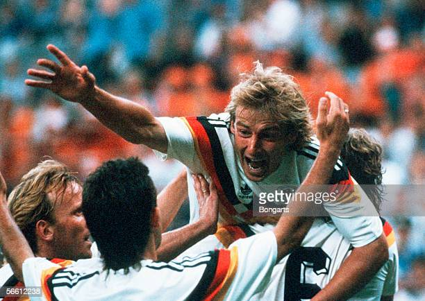 Juergen Klinsmann Andreas Brehme and Pierre Littbarski of Germany celebrates scoring the first goal during the World Cup eighth final match between...